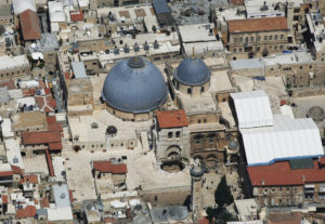 The Church of the Holy Sepulchre from above, huddled in by surrounding buildings (Ilan Arad / Wikimedia)
