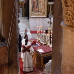 Greek Orthodox clergy at altar in the Katholikon (Seetheholyland.net)