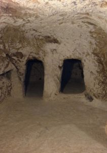 Kokhim tombs inside the venerated cave (© Gregory Jenks)