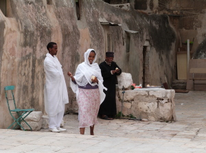 Members of Ethiopian Orthodox community at lunch on roof of Church of the Holy Sepulchre (Seetheholyland.net)