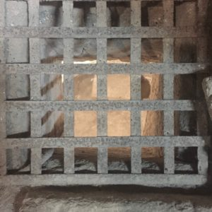 Metal grille, probably Crusader, placed to allow pilgrims to view the cave-church altar (© Gregory Jenks)