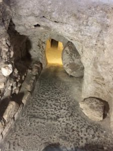 Rolling stone at entrance to burial cavities (© American Friends of the Episcopal Diocese of Jerusalem)