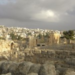 Ruins of ancient Jerash with modern city in the background (Britchi Mirela / Wikimedia)
