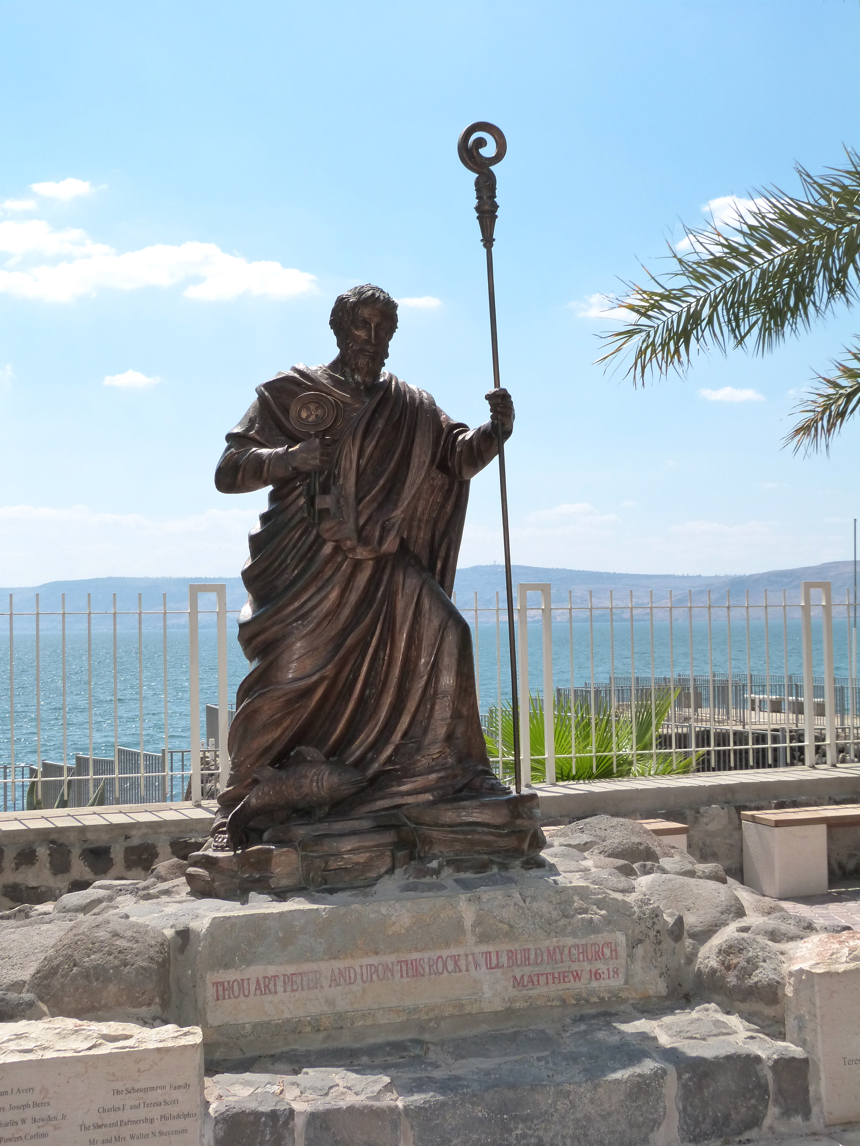 Statue Of St Peter At Capernaum With Sea Of Galilee In