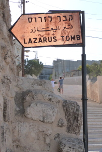 Tomb of Lazarus with security wall in background (Seetheholyland.net)